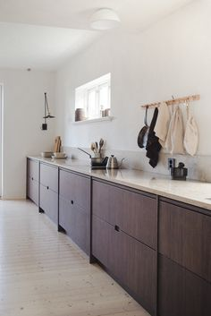 Bamboo is a fast-growing grass that's light and strong. The couple behind Oslo kitchen design firm Ask og Eng show its application in their own home. Kitchen Grill, Long Kitchen, Oslo, Installing French Doors, Ikea Kitchen Cabinets, Kitchen Views, Custom Kitchens, Cozy Place, Bespoke Design