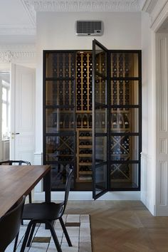 We love this wineceller featured in Scandinavian luxury apartment- Interior design at its best.