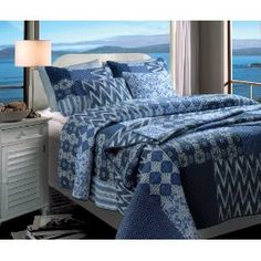 Greenland Home Fashions Santorini Full/Queen 3-Piece Quilt Set :           This patchwork quilt set is a sophisticated combination of indigo, blue, white and ivory prints. Stripes combine with geometric, floral and ikat patterns for an eclectic ensemble. 100-percent cotton face, back and fill. Each set comes with two pillow shams (one sham per tw...