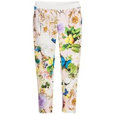 Girls long length leggings by Roberto Cavalli, with the designer's fabulous 'wonderland' floral, fruit and butterfly print. Made in stretchy cotton jersey, they have a comfortable, black, elasticated waistband, and the designer's metallic gold 'RC' logo.