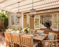 This teak set is gorgeous, and the outdoor lighting is perfect for this bringing-the-inside-out look.