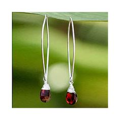 @Overstock - These stylish, sterling silver drop earrings feature gorgeous garnet gemstones set in silver swirls and hanging from oval loops. Handmade by the artisans at NOVICA, in partnership with National Geographic, these earrings exhibit quality craftsmanship.http://www.overstock.com/Worldstock-Fair-Trade/Sterling-Silver-and-Garnet-Sublime-Drop-Earrings-Thailand/4068377/product.html?CID=214117 $39.99
