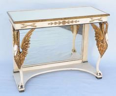 Painted and Parcel-Gilt Pier Table with Mirrored Top | From a unique collection of antique and modern console tables at https://www.1stdibs.com/furniture/tables/console-tables/