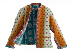 """womans hand-stitched garment made from vintage dowry quilts- The joannajohn Collection.  These 100% cotton quilts have a rich color palette with unexpected pairings, as folk art often does. The quilting is achieved with tiny spaced rows of small KANTHA hand stitching which amplifies the texture. Each piece is HANDMADE, ONE-OF-A-KIND and REVERSIBLE."""""""