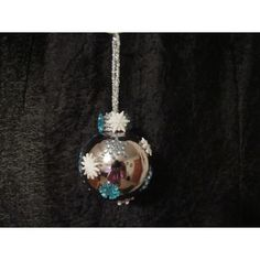 This beautiful handcrafted ornament is created with a silver glass ornament with snowflakes scattered around it. Fabric Ornaments, Ball Ornaments, Handcrafted Christmas Ornaments, Glass Ball, Snowflakes, Gemstones, Silver, Handmade, Beautiful