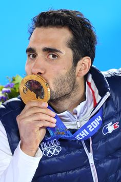 Gold medalist Martin Fourcade of France celebrates during the medal ceremony for the Men's Individual 20 km (c) Getty Images Sotchi 2014, Jesus Navas, Olympic Winners, Branding, Winter Games, Jimmy Fallon, Sport Man, David Beckham, The Man