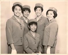(Center) Sumiko Carroll (née Namihira) flight attendant for Northwest Orient Airlines (1966)