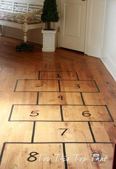 Indoor hopscotch with tape for the impending doom of winter in a small house with two rowdy boys!