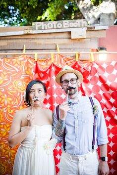 I think it would be SO fun to have a 'photo booth' at wedding reception... you could get funny pictures of all your guests, what great memories!!