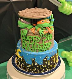Andrew's Teenage Mutant Ninja Turtles cake! 2 tier, 8 inch and 6 inch 2 layer round cake! All buttercream and candy clay! No fondant! The Turtle's heads are made from rice krispy treats and candy clay! For even more fun each layer of the cake inside is a different color to represent the Turtles! Red, blue, orange and purple!  Pic by Abbey DeHart!