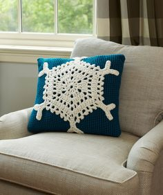 Snowflake Pillow. This stunning snowflake pillow will be enjoyed all winter long! Pillow cover is crocheted and snowflake motif is crochet separately then stitched in place.