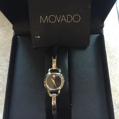 🎉🎉HP 5/29🎉🎉🎉Movado Bela Black dial watch New, Never worn Women's Bela watch, 25 mm stainless steel case, black Museum dial with silver-toned dot and hands, slender stainless steel bangle-style bracelet with back sizing links .This contemporary women's watch features a narrow bangle-style bracelet with removable back links for a customized fit. Movado Accessories Watches