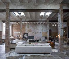 Amazing warehouse apartment with exposed brick, and square brick pillars.  dream apartment