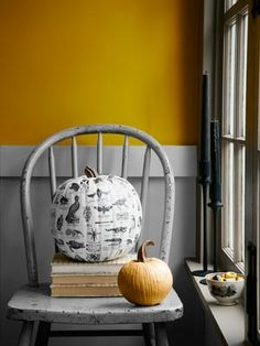 How to decoupage pumpkins with cool black-and-white illustrations: http://www.countryliving.com/crafts/projects/painted-pumpkins#slide-1