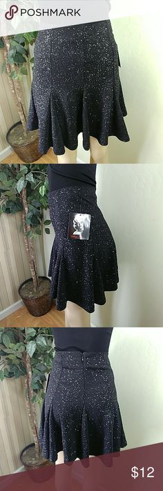Marilyn Monroe 1020 Above the knee Skirt Marilyn Monroe 1020 above the knee skirt, size small, color black with glitter accent,  back zipper closure, elastic waist, circle fall right above The Knee, compare $29.00 retail price value, comes new with tag as closeout merchandise in good cosmetic condition. Marilyn Monroe Skirts Mini