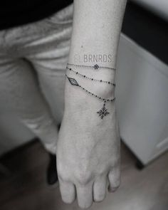Ornamental bracelet tattoo on the left wrist. Tattoo Artist: Elda Bernardes