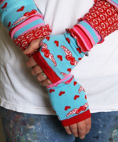 Aqua and red arm warmers... made from socks.❤ Great way to use those socks with holes in the heels.