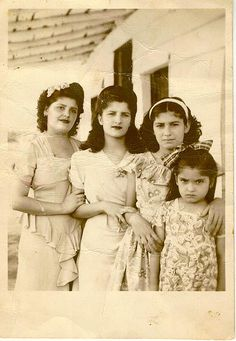 "Sisters. Reminds me of Eva, Ena, Elia and Elvira en Menocal.  Photo by Jose Rojas and he said this was a photo at his mom's ""Chekee"" (bohio) house at Cacique, small village in central Cuba."
