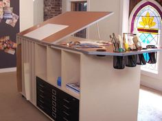 Love this DIY art studio table. Here's how: http://www.diynetwork.com/how-to/how-to-build-an-art-table/index.html
