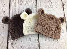 This hand crochet baby bear beanie is extra cute with a textured stitch and little ears! (Shown above from left to right in Taupe, Cream and