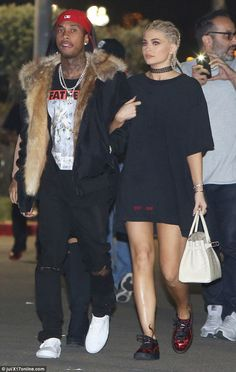 Date night: Kylie Jenner, 19, hung onto boyfriend Tyga's arm as they arrived for Kanye West's LA concert at the Inglewood Forum on Tuesday night