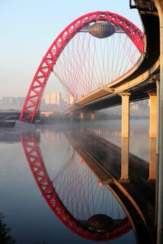 Picturesque Bridge in Moscow - love the idea of a hanging pod below the bridge!