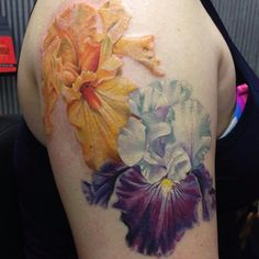 """Purple Iris is healed. Added the orange one - thanks Kristin for a fun project - foliage to come. @eternalink @neotatmachines #flowertattoo #iristattoo…"""