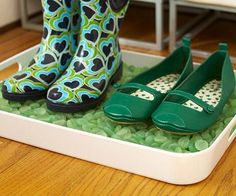 Keep wet boots off hardwood floors with a shoe tray. How-to, plus more decorating ideas under $20: http://www.midwestliving.com/homes/decorating-ideas/projects-under-20-dollars/page/7/0