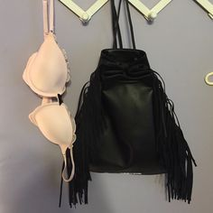 Fashion show bag and bra Drawstring limited edition Victoria's Secret fashion show bag. Beautiful fringe on the sides!  price is negotiable! NWT for the bag and EUC for the bra! PINK Victoria's Secret Intimates & Sleepwear Bras