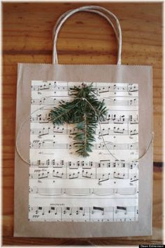 Music Sheet Gift Bag. No need to buy a fancy gift bag when you can make a spectacular one in minutes. Embellish a plain shopping bag with greenery, music sheets and string.