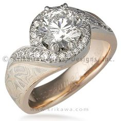 Pave Swirl Mokume Engagement Ring - This mokume engagement ring has paved diamonds swirling around the center diamond.  Ideal cut accent diamonds.