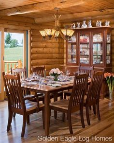 A rustic and elegant dining room. #loghomeliving #construction #loghomes #loghome #logcabins #cabin #logcabins #home #homes #houzz #outdoors #nature #rusticliving