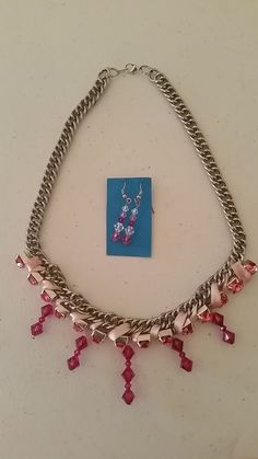 Chain necklace with pink ribbon and pink crystals with matching earrings