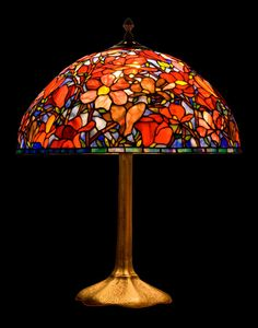 Size: • Diameter of shade 36 cm (14) • Height of a lamp 55 cm (20) • Amount of glass pieces: 1161  Main style of the lamp: Tiffany Magnolia mini-version  Stained glass lamp, made using L.C. Tiffany metod of copper foil and glass from Uroboros and Youghiogheny. These are American most famous glassworks. Every glass pane is manmade. Solders are very solid and smooth, what guarantee durability for dozens of years. It's handmade product made in Gdansk, Poland. Lamp is very nice in touch and…