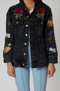 05531c2c22a Studded denim jacket with flower patches throughout. Classic collar and  front button up closure.