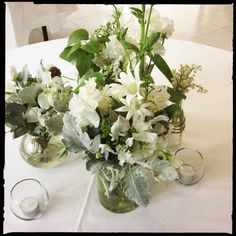 White blooms in jars.