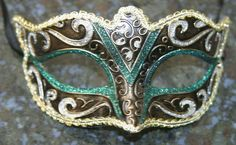 Green, Gold, Bronze and Silver Masquerade Mask Green and gold masquerade mask - great for both men and women! Mascarade Mask, Silver Masquerade Mask, Masquerade Party, Paper Mache Mask, Beautiful Mask, Venetian Masks, Homemade Face Masks, Mask Party, Diy Mask
