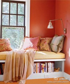 Reading nook/extra bed in a window sill, love the wall color