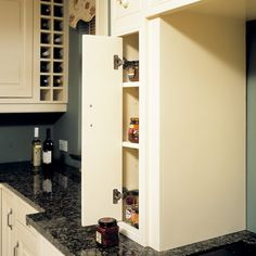 I like the skinny cabinet on the side of the stove and love the built in wine storage to the left