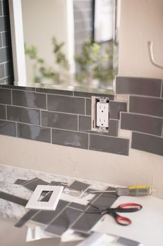 Installing tile can be tedious. Learn how easy it is to install peel and stick backsplash tiles for an affordable bathroom remodel. Peel N Stick Backsplash, Peel And Stick Tile, Stick On Tiles, Kitchen Backsplash, Smart Tiles Backsplash, Backsplash Ideas, Rv Makeover, Home Upgrades, Diy Home Improvement