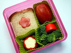 Bento box lunch - Almond butter & honey sandwich, apple slices, cheese (used a small cookie cutter to cut out the flower shape), broccoli & yogurt dip!
