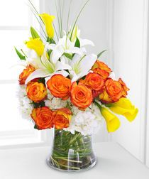 A Splash of Sun --  What a simply beautiful way to let someone know you're thinking of them! The beauty of summer is here with this stylish, elegant bouquet featuring clouds of #hydrangea surrounded by sun kissed #roses and calla #lilies.