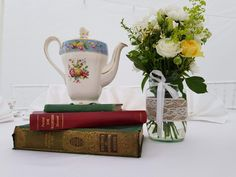 Add a touch of nostalgia to your wedding reception tables with vintage books and floral China displays. Vintage Props, Vintage Table, Unique Vintage, Sweet Carts, China Display, Afternoon Tea Parties, Wedding Reception Tables, Vintage China, Tea Pots