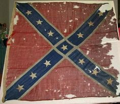 """Pvt. George W. Wise of the 19th SC Infantry Regiment carried this flag into battles from middle Tennessee to Atlanta. """"It was shot out of his hands in Murfreesboro in 1863, and he probably dropped it when he lost his left arm in a battle at Shelbyville,"""" reported the Charleston Post and Courier. """"But Pvt. Wise never really let go of that flag. When the war ended, Wise carried the tattered, bullet-riddled banner home."""""""