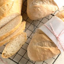 These batards (or Italian-style loaves), featuring a crunchy crust and chewy interior marked by irregular holes, are a perfect accompaniment to any meal. They also make great sandwiches. The poolish (or starter), made the night before, gives the bread its excellent texture and flavor; while not difficult to make, this bread does take some time, so plan accordingly.   Like any loaf made without fat, they become stale very quickly. So bake and eat them the same day or, if they're day-old…