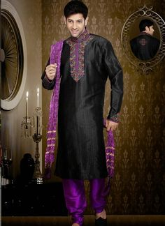 Classy look black art silk sherwani is designed with cut work and stone work. Comes with matchnig dupatta shown as photography purpose. (Slight colour variation is possible.)...