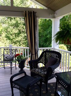 Love these Sunbrella black and white striped outdoor curtains. Create a cabana feel
