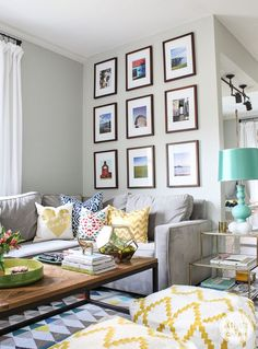 Love this living room! The color combo of deep blues, yellow golds, & pops of red are fabulous. Plus, that wall gallery really ties everything together!