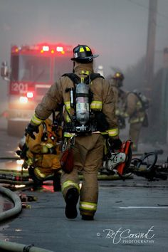 An action shot from a fire in the Bario, downtown San Diego!  I just happened to be in the right place at the right time!  I love this shot of our Firemen in action!