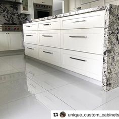 #Repost Perfection!  That is what comes to mind when we see this island from @unique_custom_cabinets!! From the #stonework to the #drawers all the way down to the #hardware = #absolute #perfection! . . . Glossy #whitekitchen #wood #woodwork #quality #island #customhomes #customkitchen #wolf #waterfall #topknobs